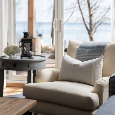 Living area with view of Lake Erie through glass doors
