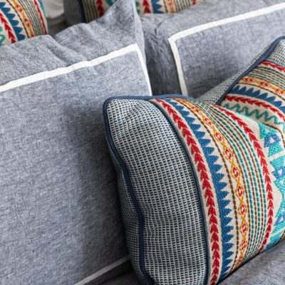 Close up of decorative pillow on bed